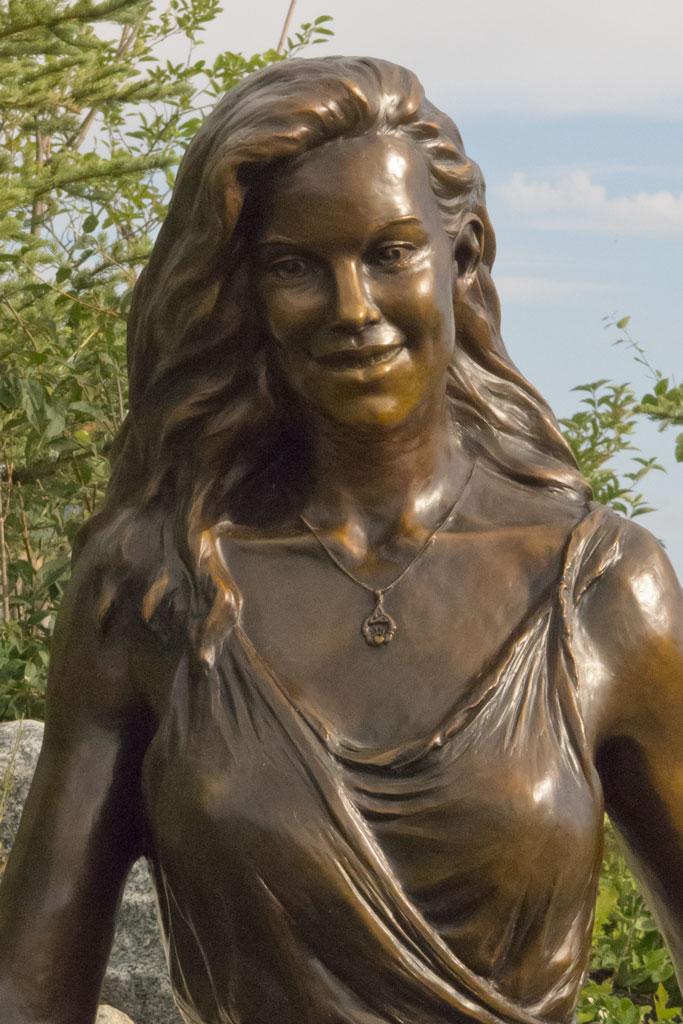Bronze portrait sculpture of a young woman by portrait sculptor Lena Toritch