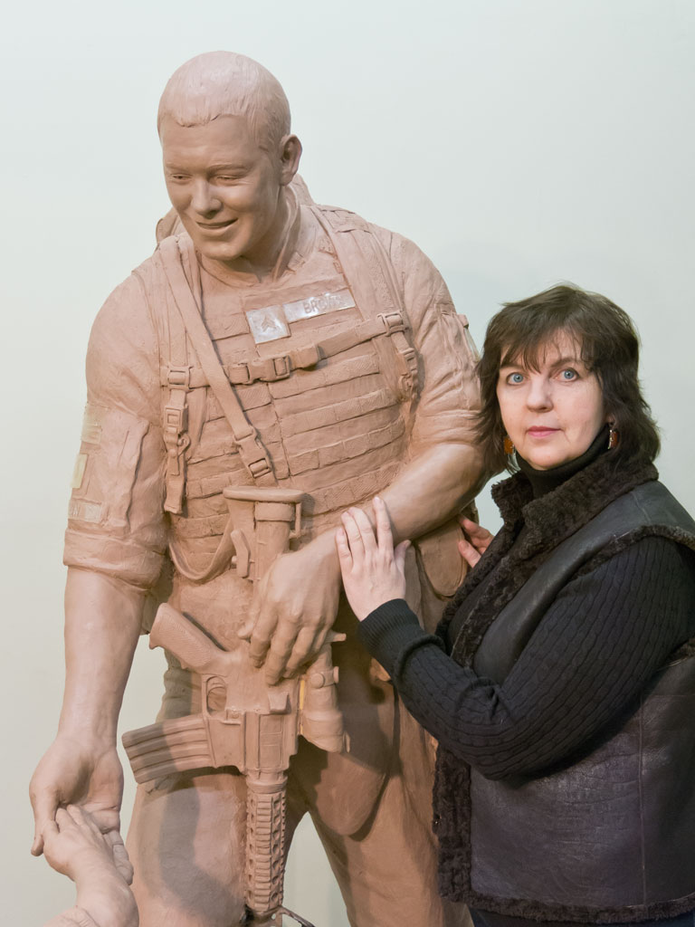 Sculptor Lena Toritch with Sgt. Dan Brown statue