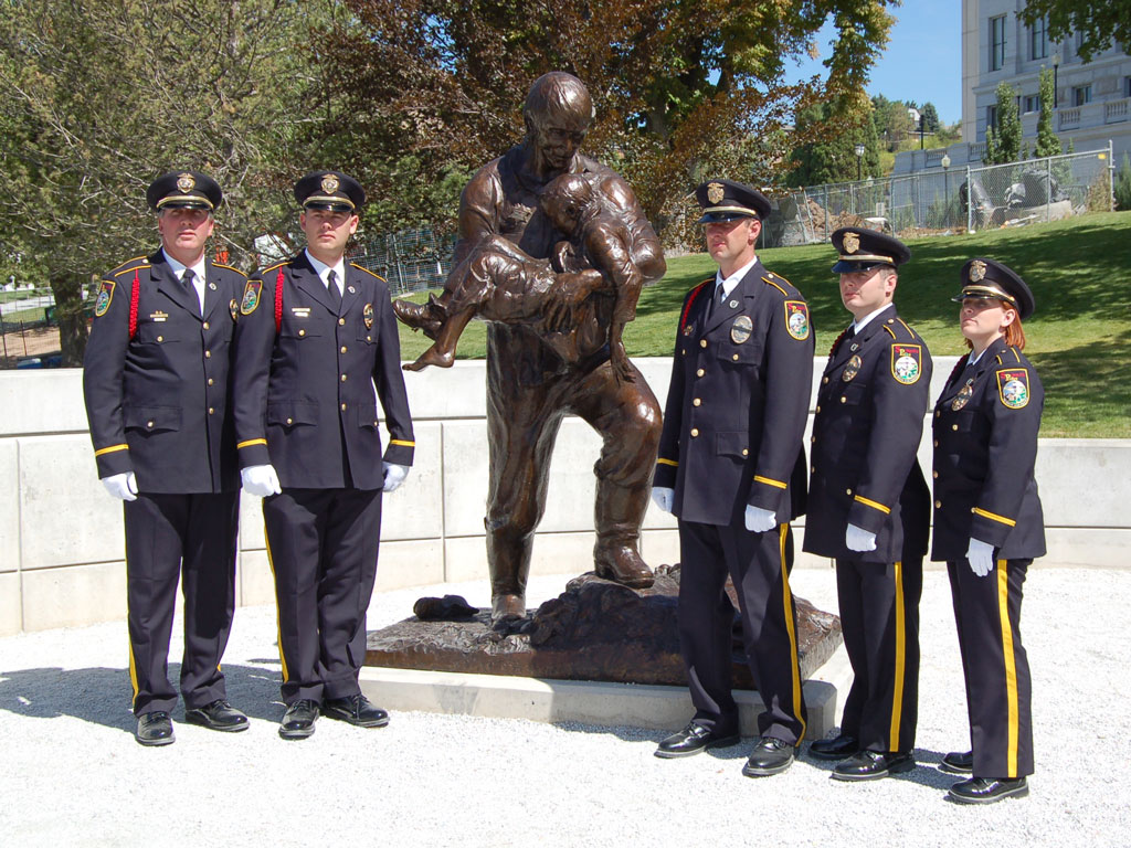 Rodney Badger Police Memorial portrait sculpture with Officers.Heroic size bronze monument