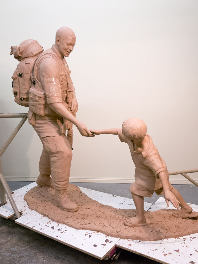 Sgt.Dan Brown and child military monument sculpture clay statue
