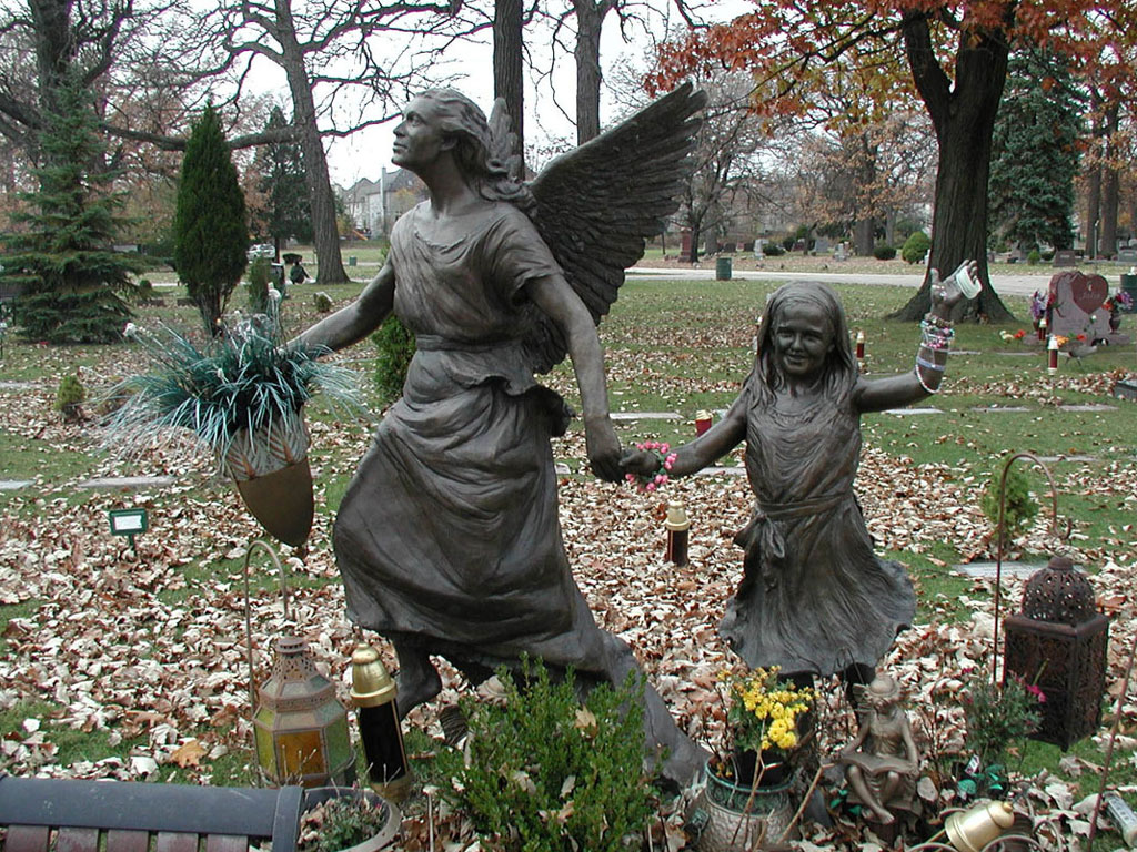 Bronze memorial statue of an Angel and child by Lena Toritch