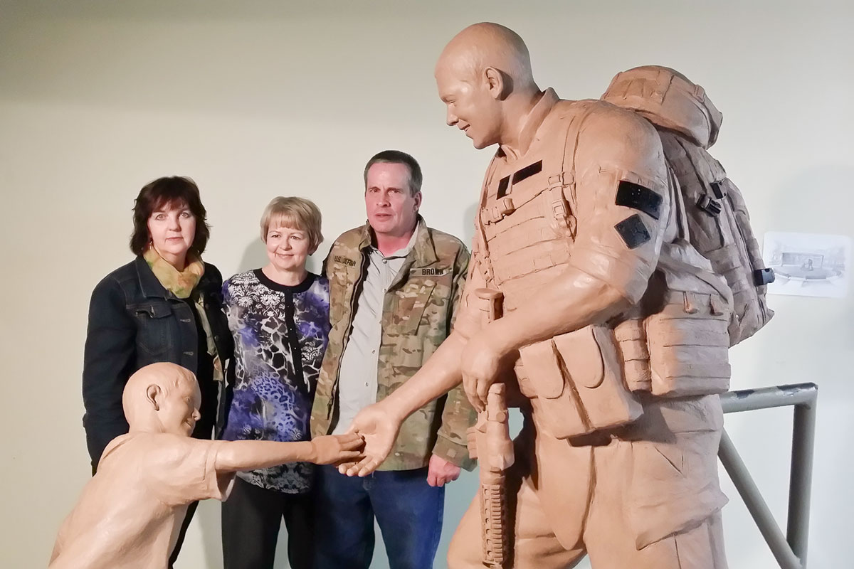 Lena Toritch and the Browns with Sgt.Dan heroic monument statue