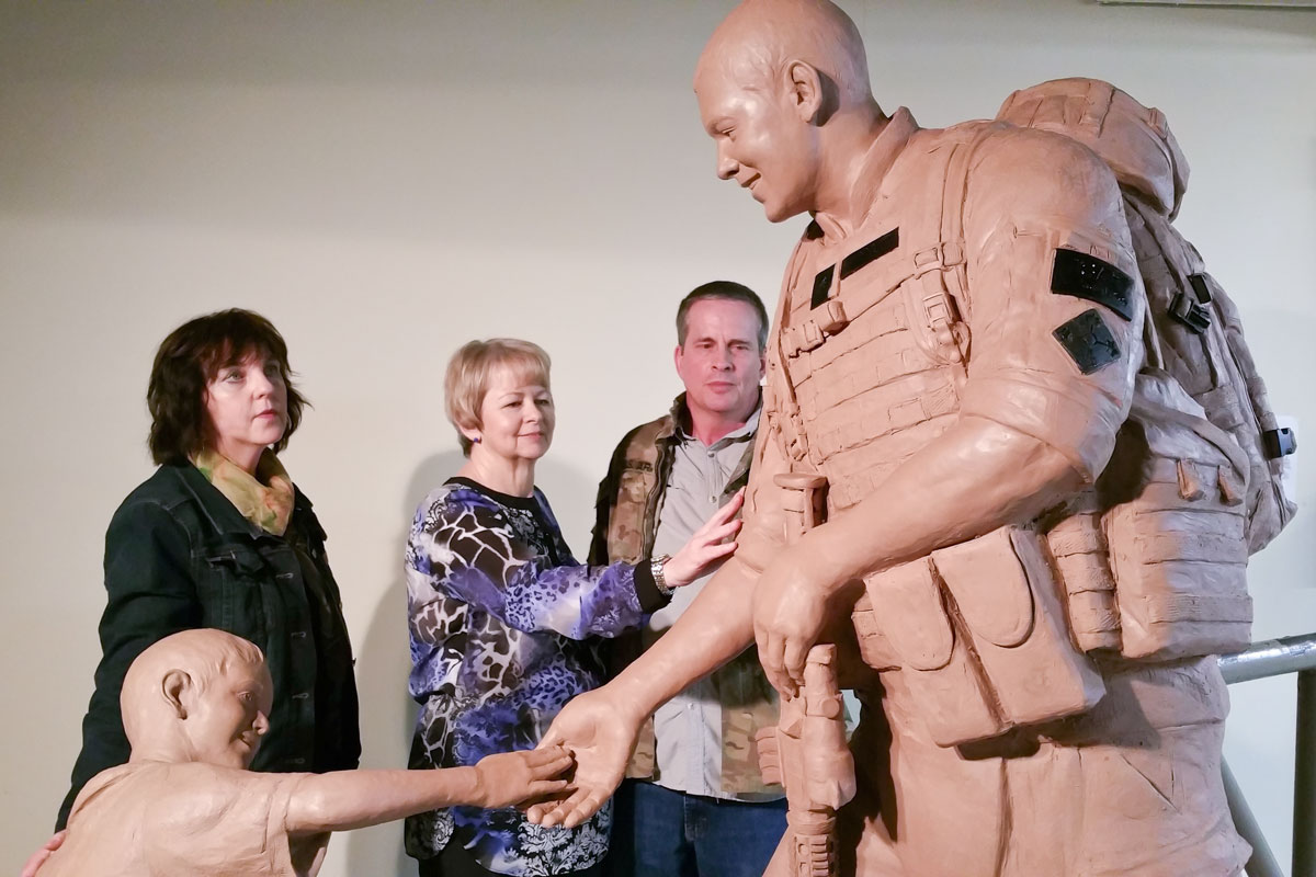 Lena Toritch and the Browns with Sgt.Dan heroic monument sculpture