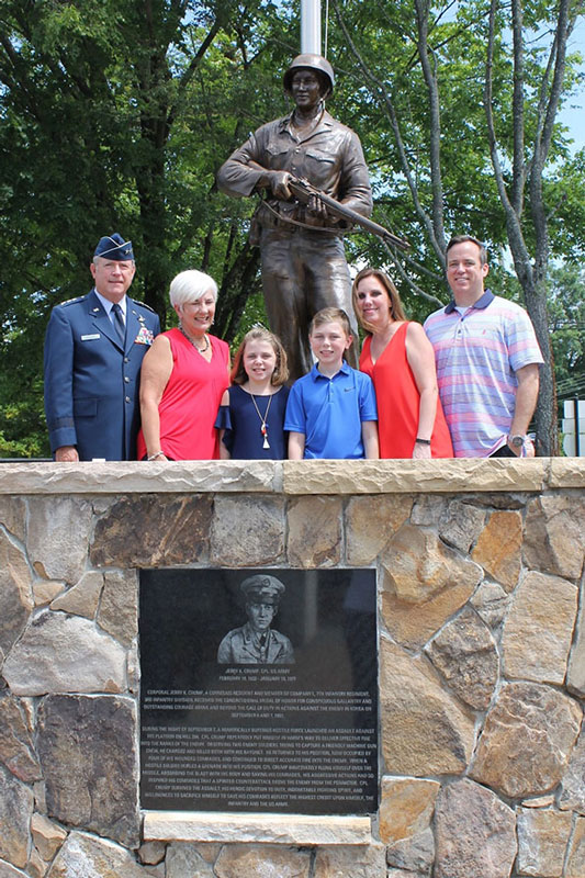 The Crump Family with Bronze Statue of Cpl. Jerry K. Crump with Placard