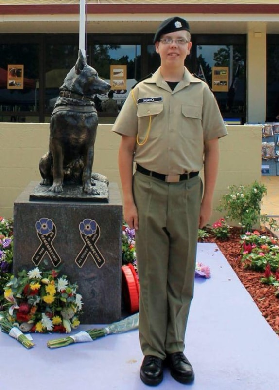 Cadet with K9 statue